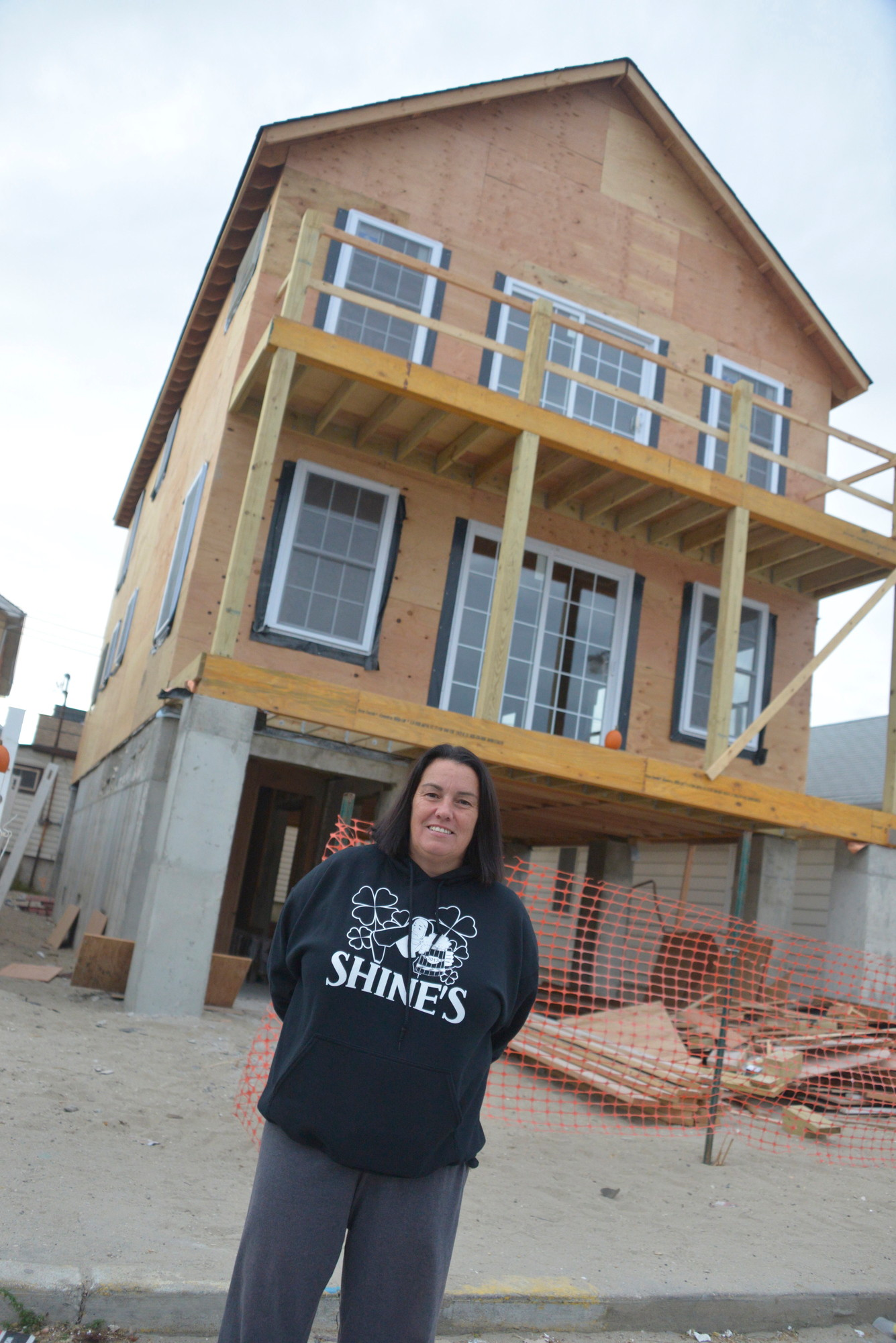 Pennsylvania Avenue resident Sam Gallo in front of her new elevated home.