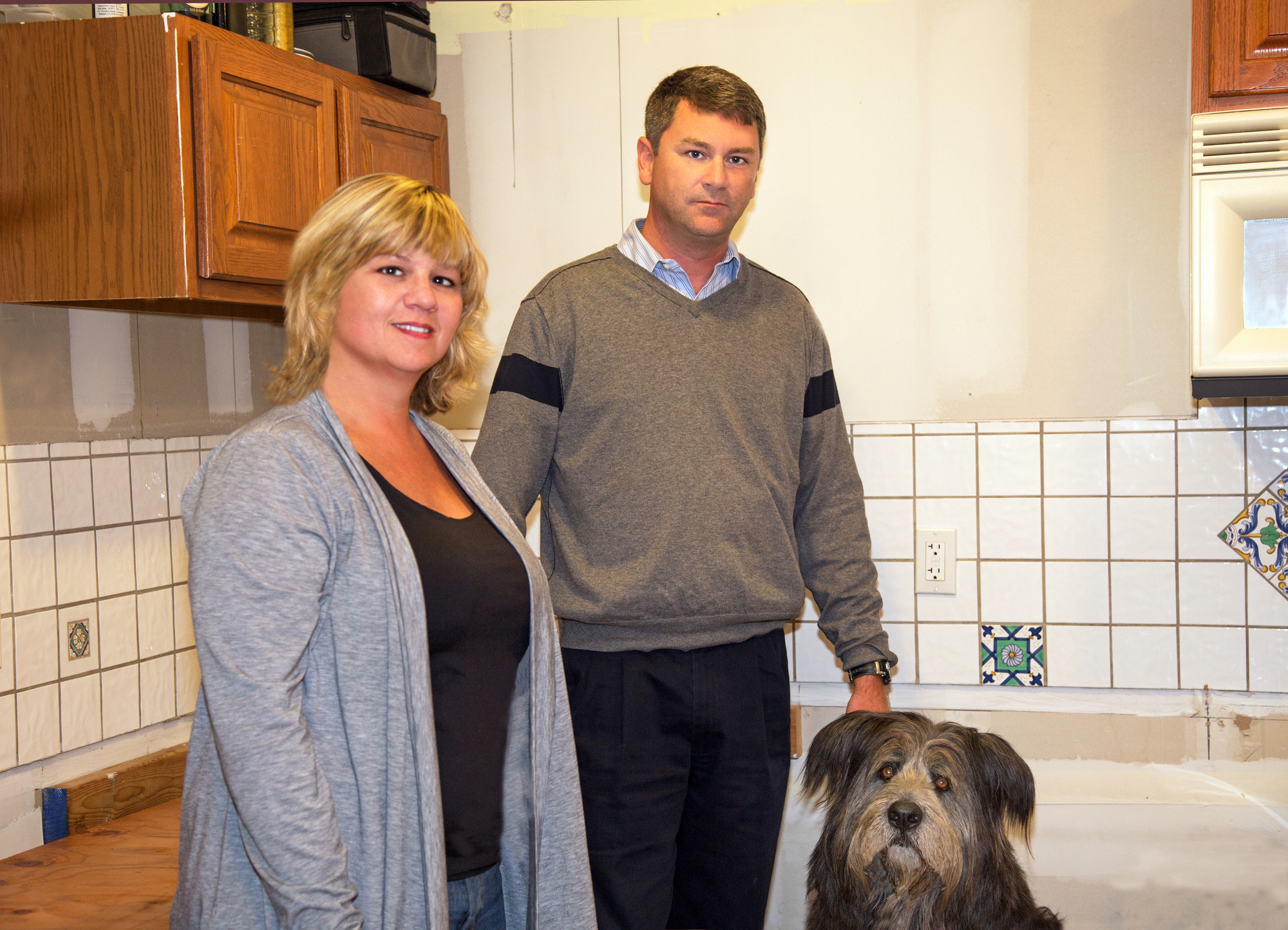 Kristie and Kevin Reilly with their dog., Marley, in their Barnes Street home.They are hoping that NY Rising funding will help them elevate their home.