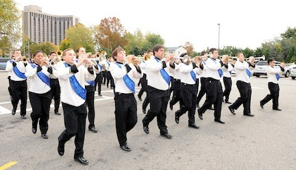 The East Meadow band led the way during the school