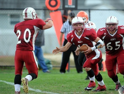 Clarke quarterback Peter Falgiano faked a handoff to Joe Truono for some play-action during the Rams