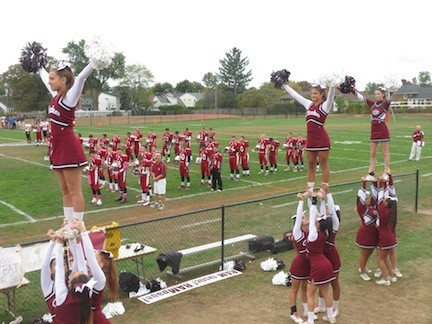 Cheerleaders helped excite the crowd during the football game.