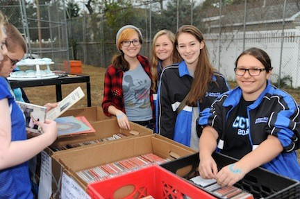 Wind ensemble members Meryl Dickstein, 16, Anna Paulin, 15, and Ashley Ann Fennema, 15, sold albums during Homecoming. Julia Polikoff, 16, lent a hand.