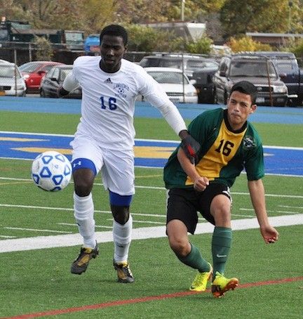 Lawrence's Wisdom Ezihie, left, worked against Lynbrook's Erik Vivar during last Friday's Class A playoff game won by the Golden Tornadoes, 1-0.