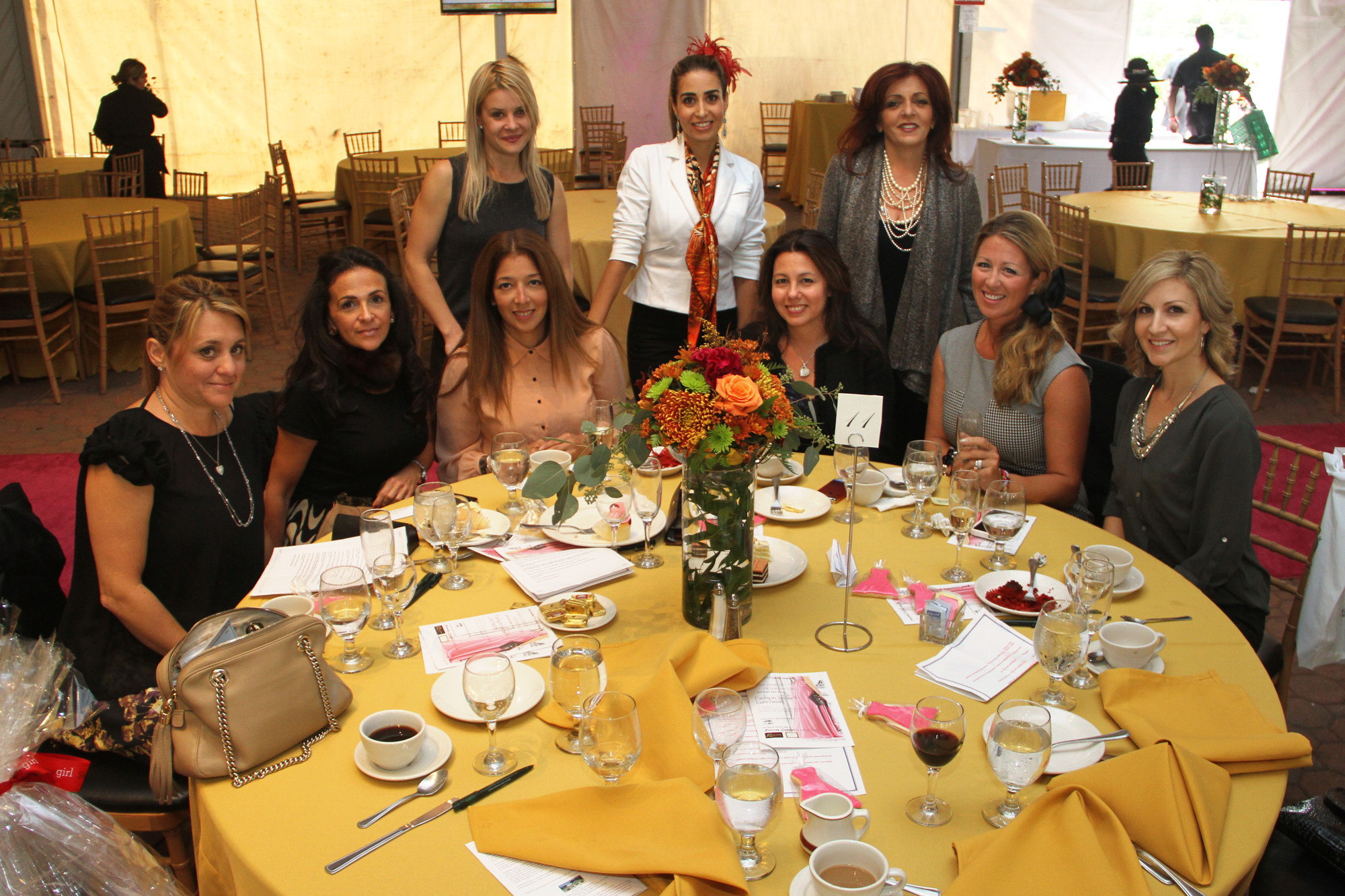 Friends Cara Williams, left, Rose Valzovano, Darcy Tabako, Cathy Bozzonu, Lisa Oliveri, Nicole Nichols, Stefanie Lazzinaro, Donna Messina and Natalia Messina shared an afternoon of fun at the fashion show sponsored by the Belmont Child Care Association.