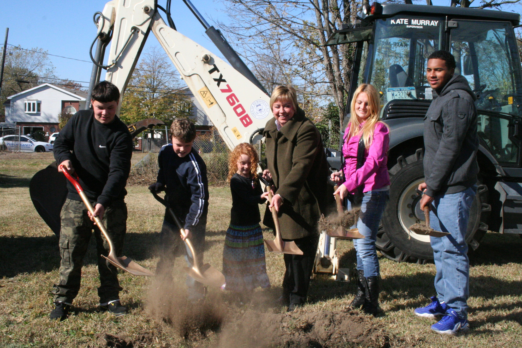 The McHale family, with help from Town of Hempstead Supervisor Kate Murray, broke ground on the new house being built for them in Inwood through the town