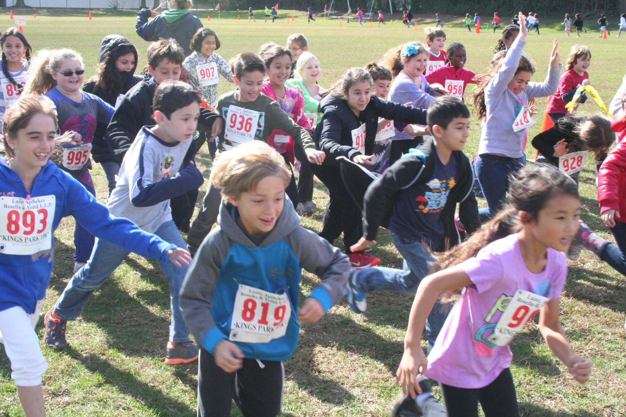 Third-graders at Ogden Elementary ran around the field after donating a pair of new or gently used shoes to Soles4Souls on Oct. 24.