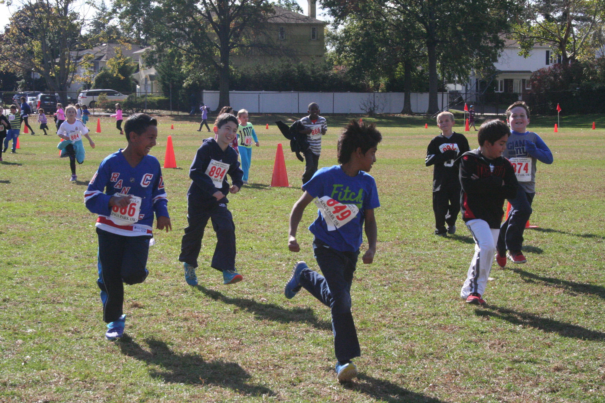 A group of fourth grade boys run together at Ogden Elementary School
