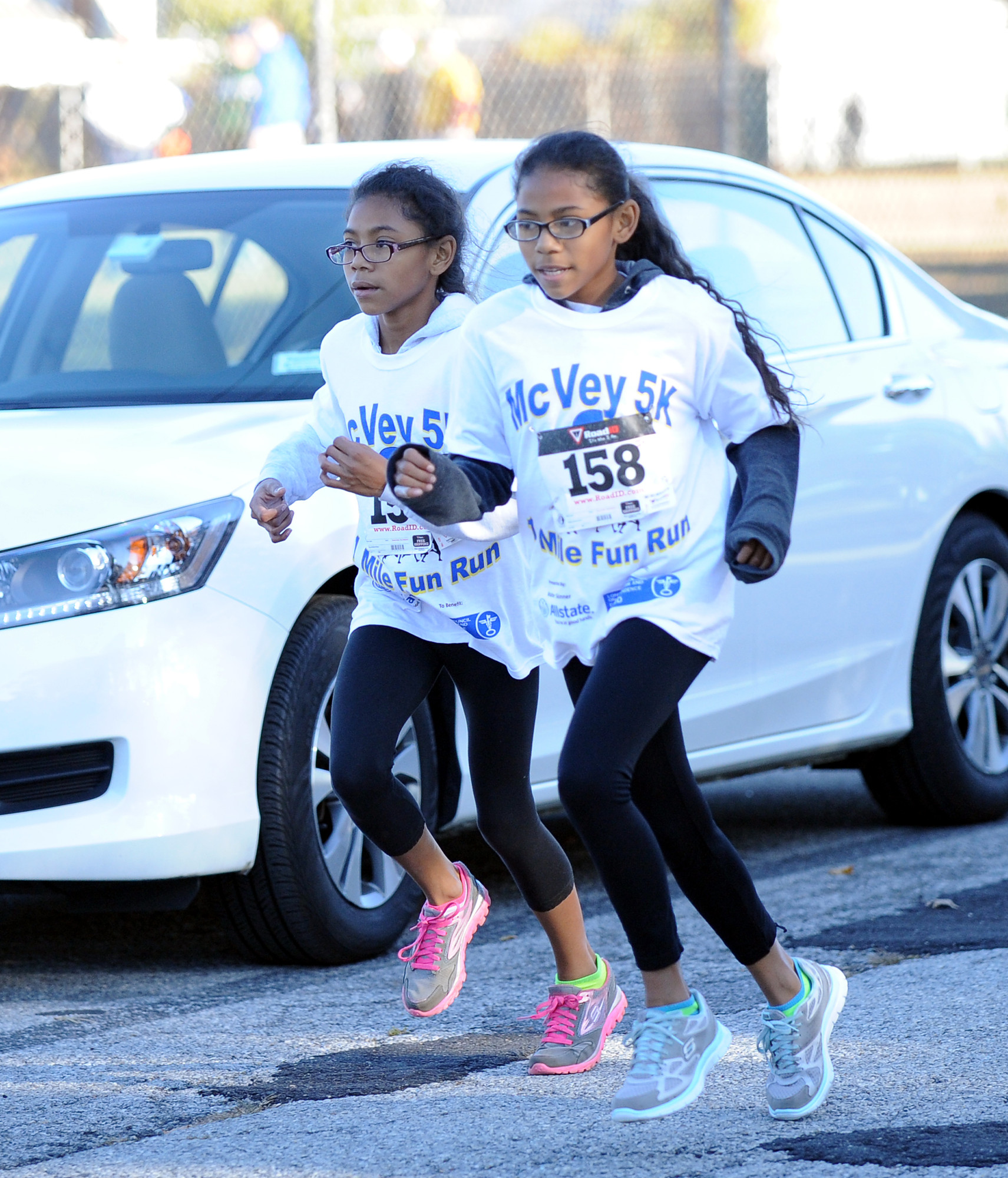 12-year-old twin sisters Isabel and Katherine Marsh ran the entire 5K race side by side.