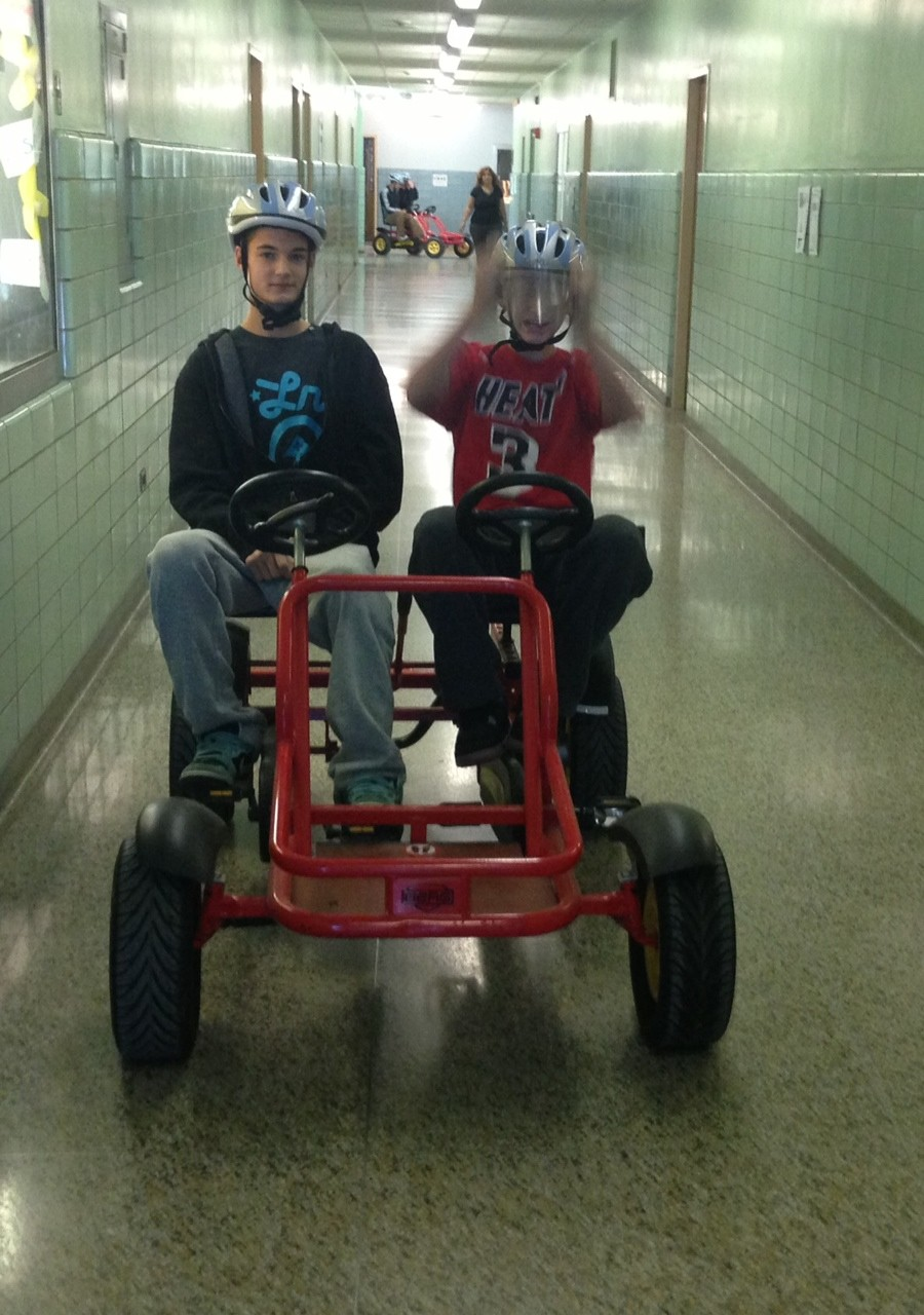 Calhoun juniors Kevin Hassan, left, and Tom Barresi gave the pedal-car simulator a try in the back hall of their school.
