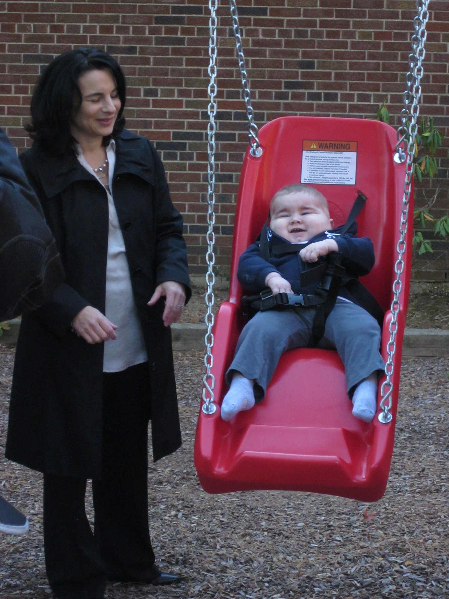 Wendy Abrams watched her son smile through his first ride on the new swing.
