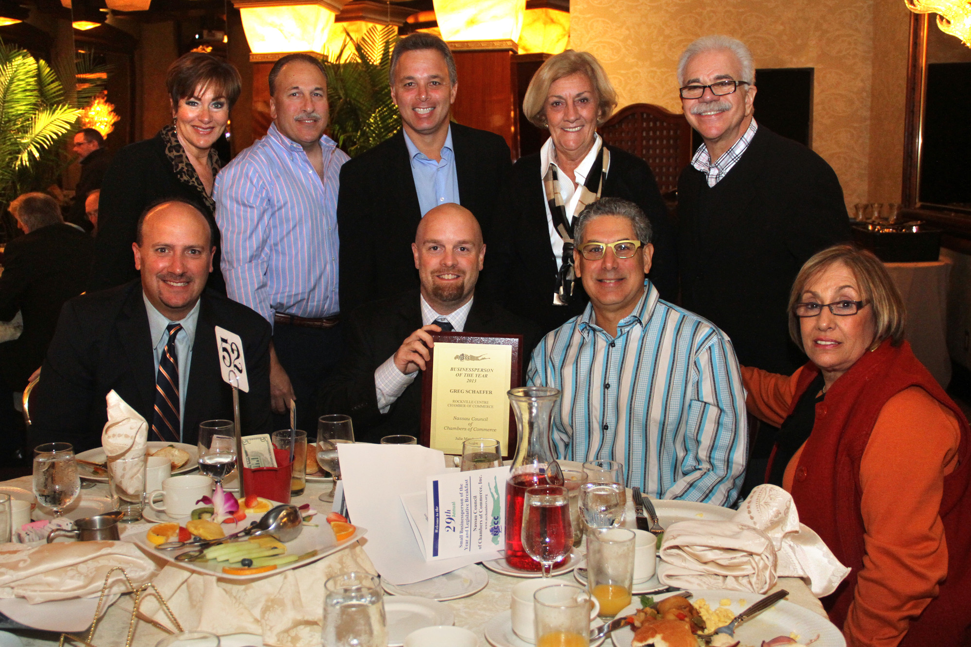 Greg Schaefer, center, with friends and colleagues from the Rockville Centre Chamber.