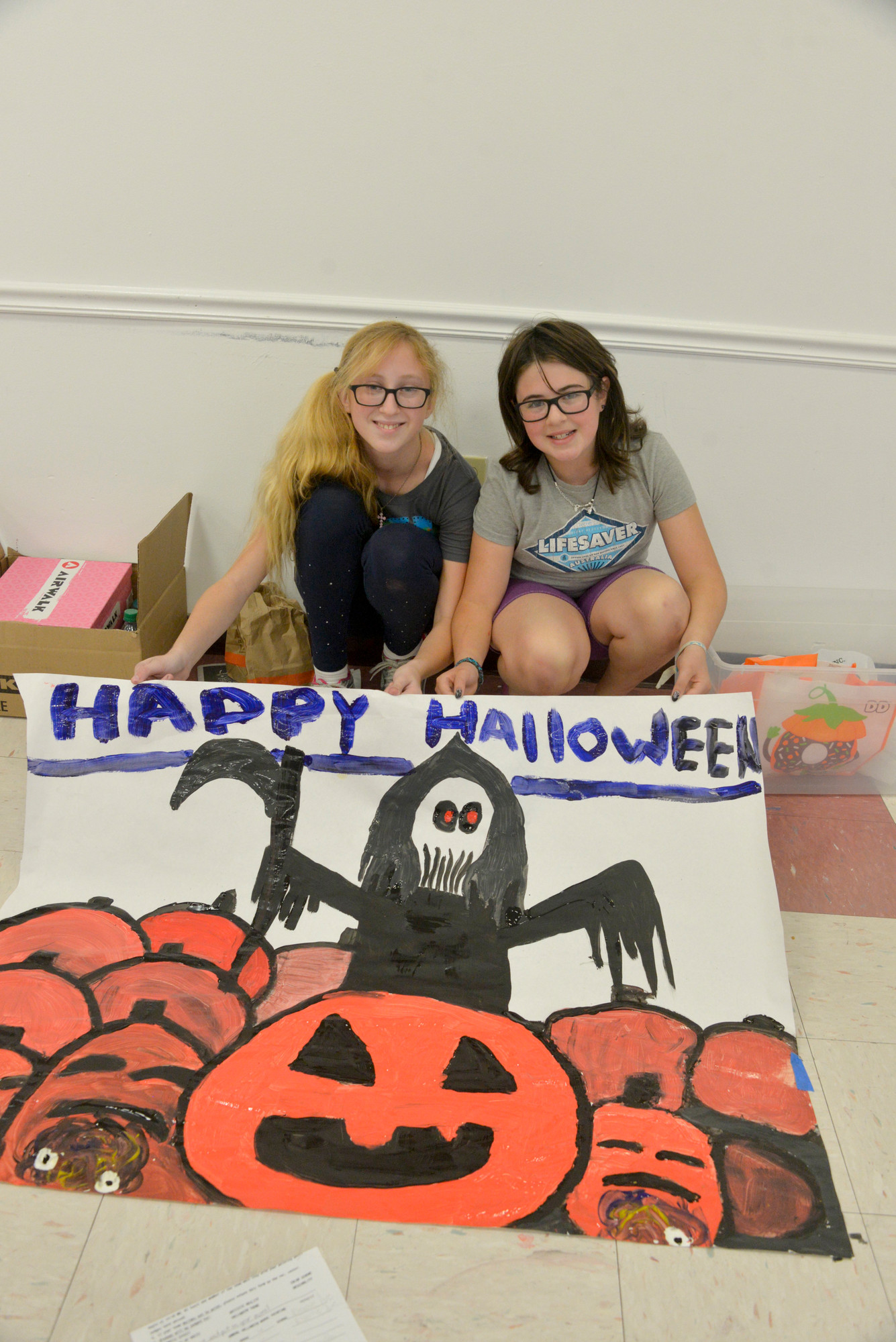 Samantha Lachiana, 12, Taylor Rampulla, 11, show off their creation at the Rec Center.