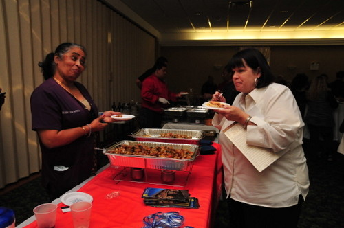Norma jean singh, of Lynbrook Restorative, served up a Cajun shrimp dish to Linda Stephenson of the Lynbrook Chamber.