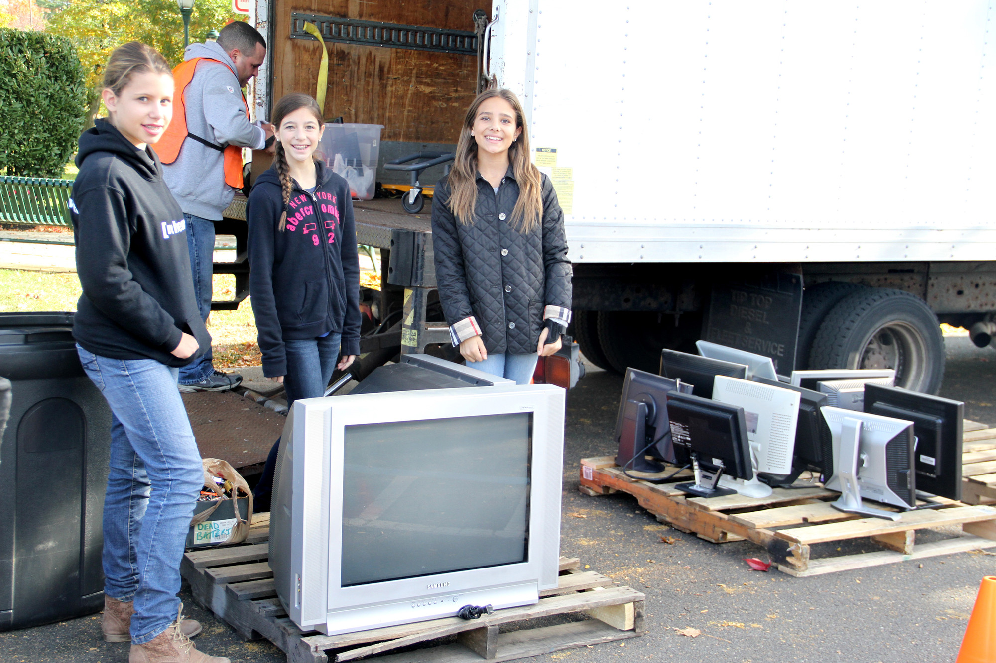Elizabeth Ray, Victoria Romano and Ali Bianco volunteered their time to help with the recycling efforts.