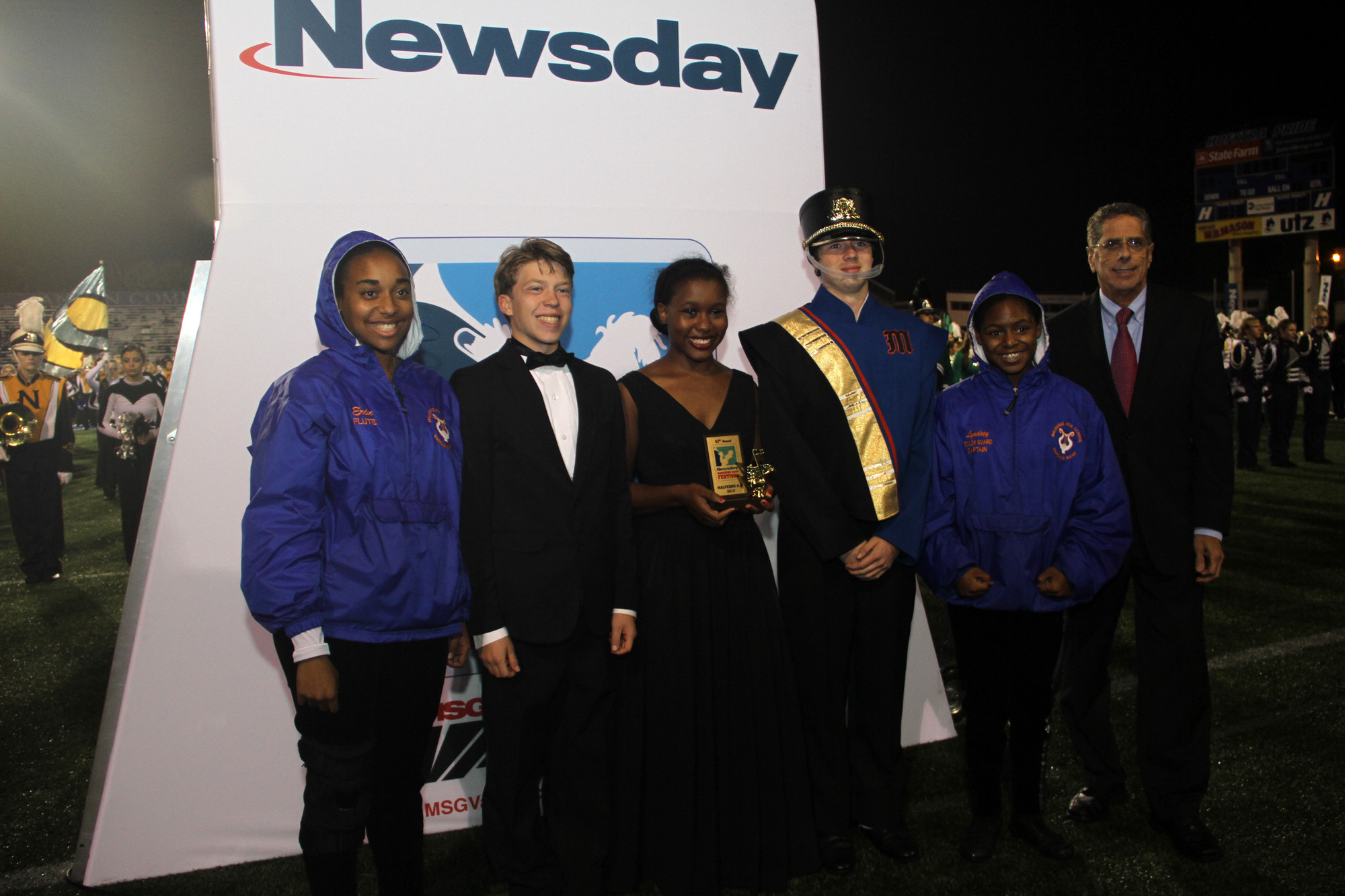 Drum Majors and Color Guard captains of the Malverne High Marching Band accepted their honorary plaque.