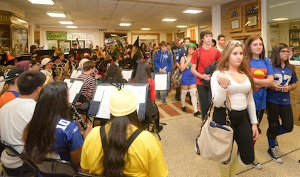 Students leave school for the day, entertained by the band.