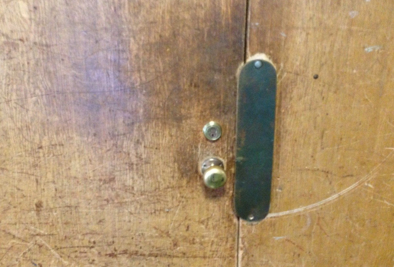Throughout the Central District, wooden classroom doors, like this one at Merrick Avenue Middle School, are scratched up from decades of use.