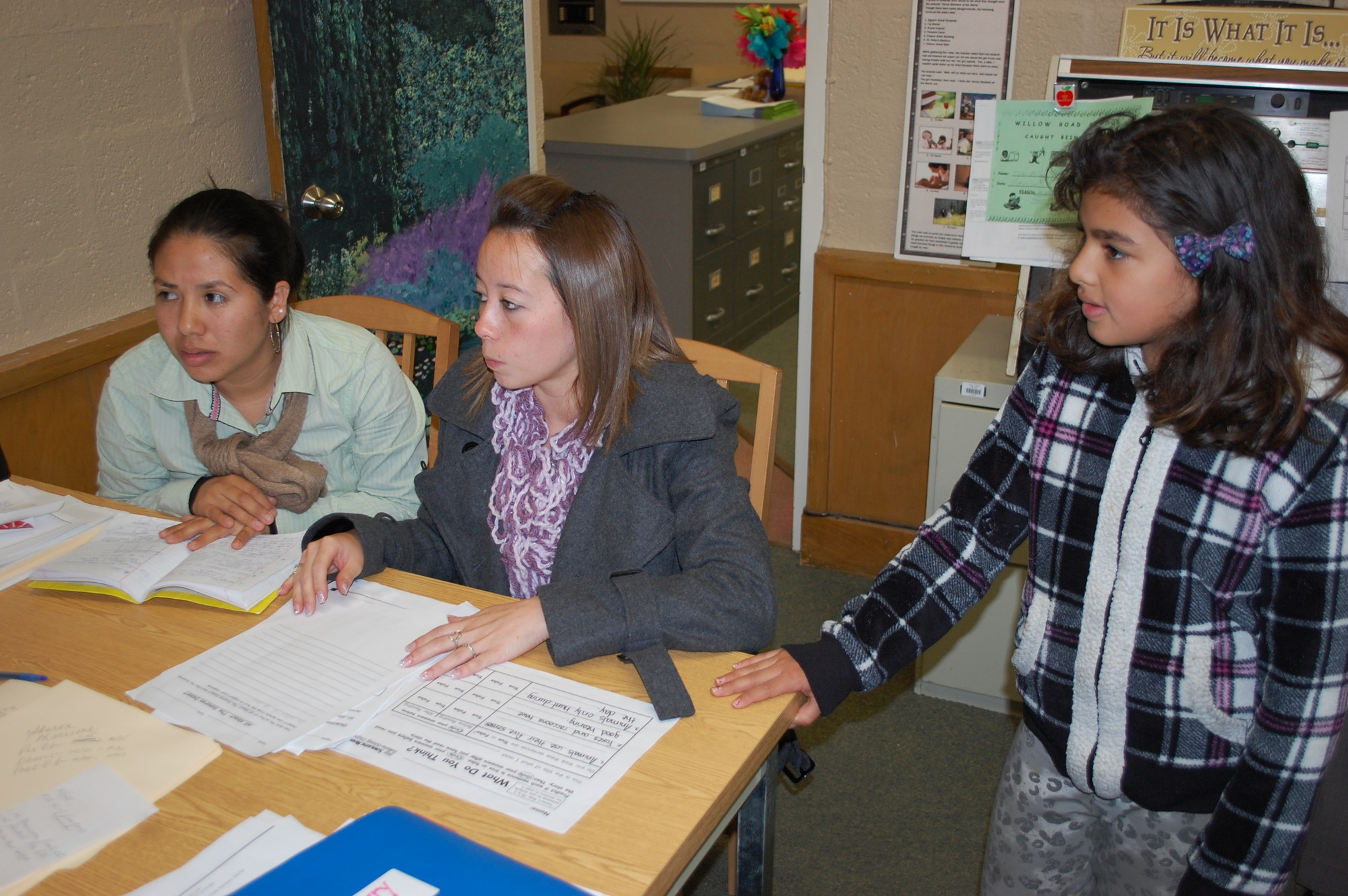 Kelly Emerson, right, a native of Guatemala and a student at the Willow Road School, met Mayra Flores and Marie Jos