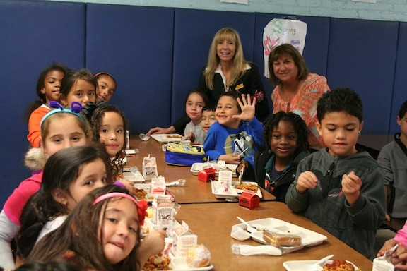 First- and second-graders with Number Five School Principal Rina Beach and social worker Robin Cutler during Mix It Up at Lunch Day.