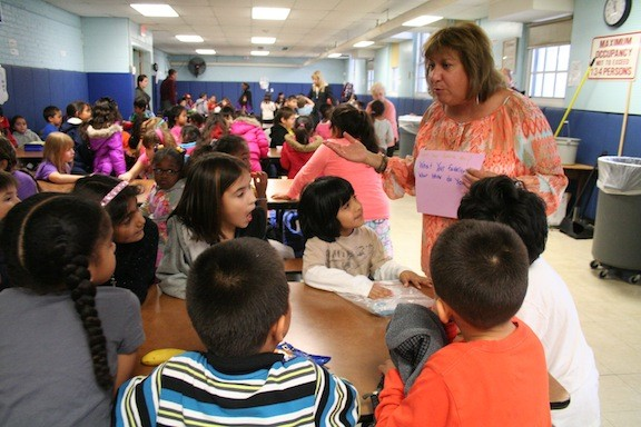 Number Five School social worker Robin Cutler gives first- and second-graders some questions to ask each other at Mix It Up at Lunch Day.