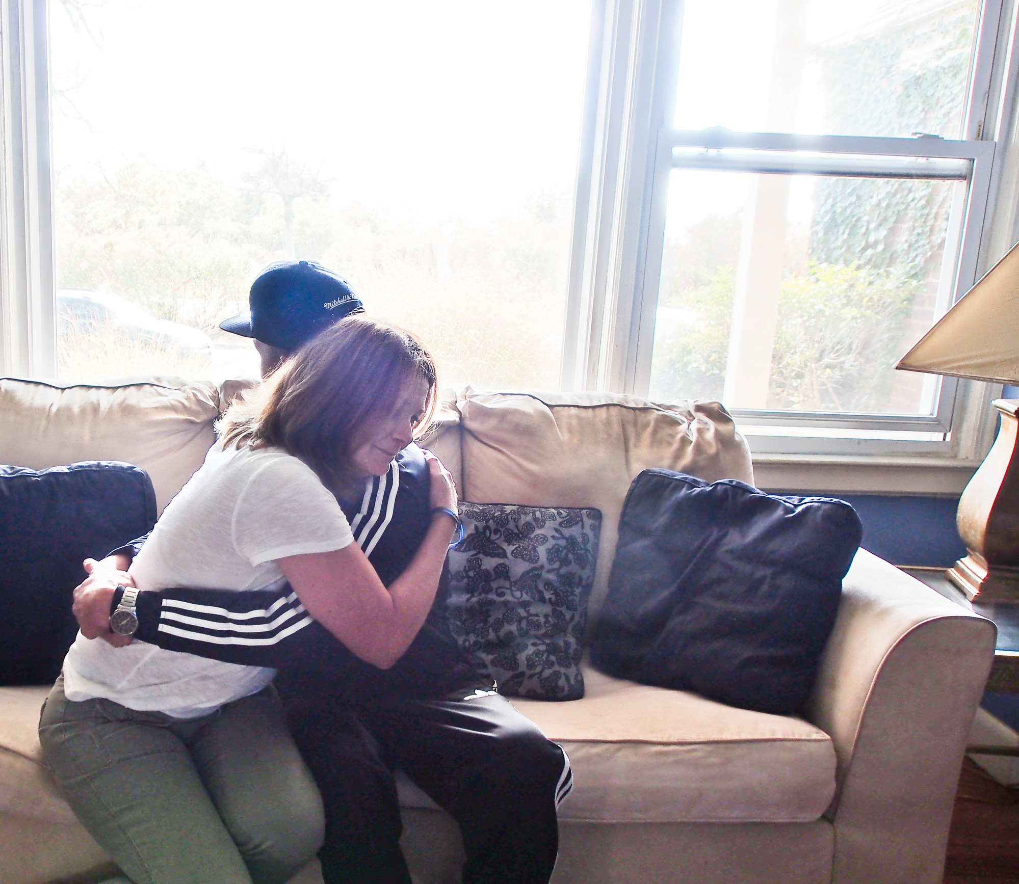 Kerri murphy hugs her son, 22, who once used up to 20 $10 bags of street heroin every day.