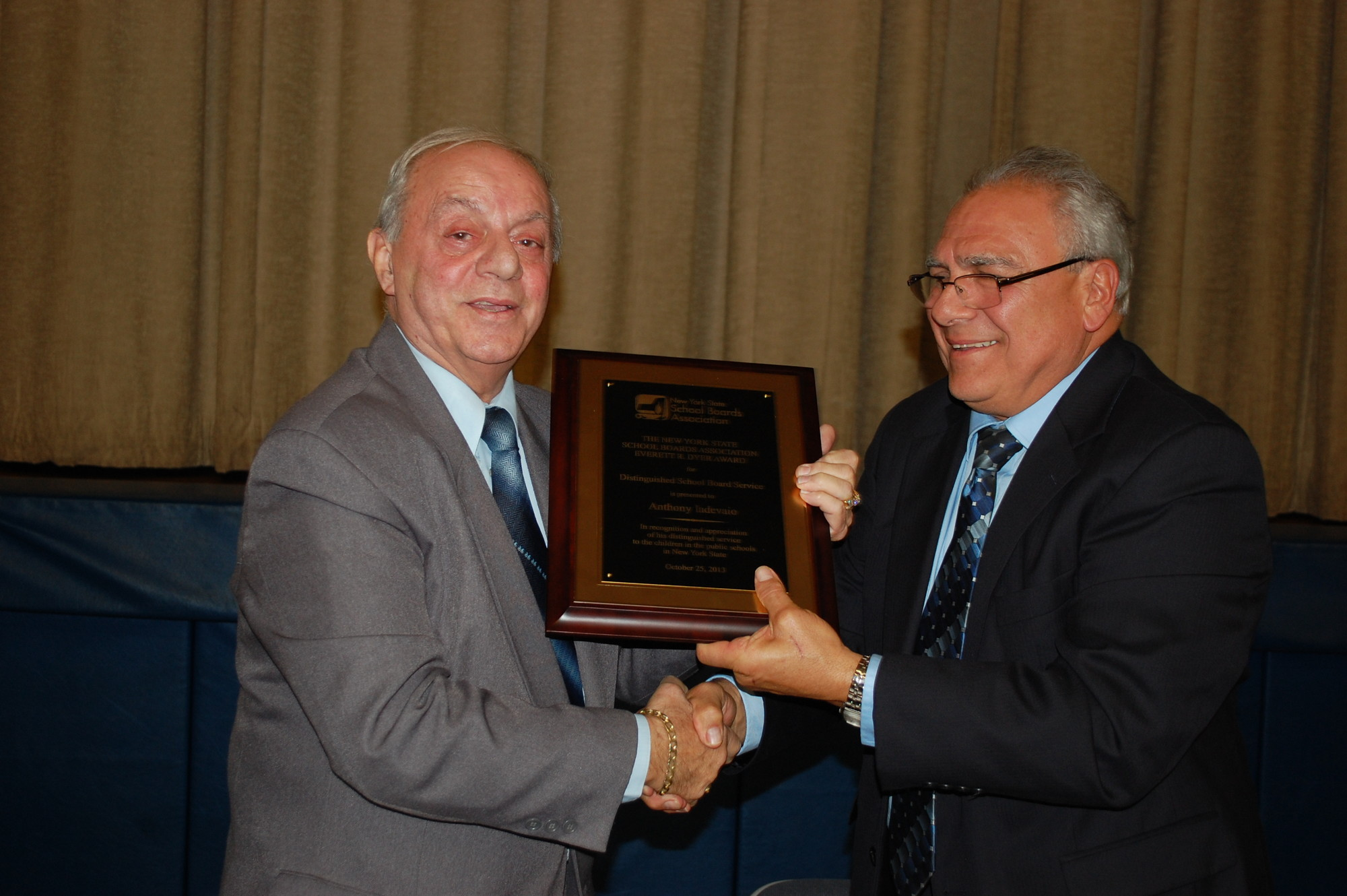 District 24 Board Trustee Anthony Iadevaio, left, receives his 2013 Everett R. Dyer Award from Board President Paul DePace at the Oct. 30 meeting.