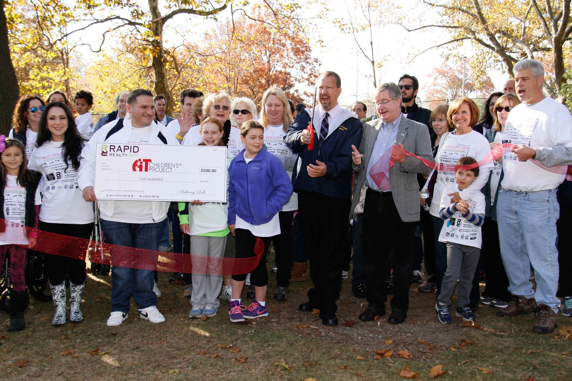 Mayor Ed Fare, along with Village Justice BobBogle, cut the ribbon to kick off the third annual Hope With Every Step fundraiser at Hendrickson Park on Nov. 2.
