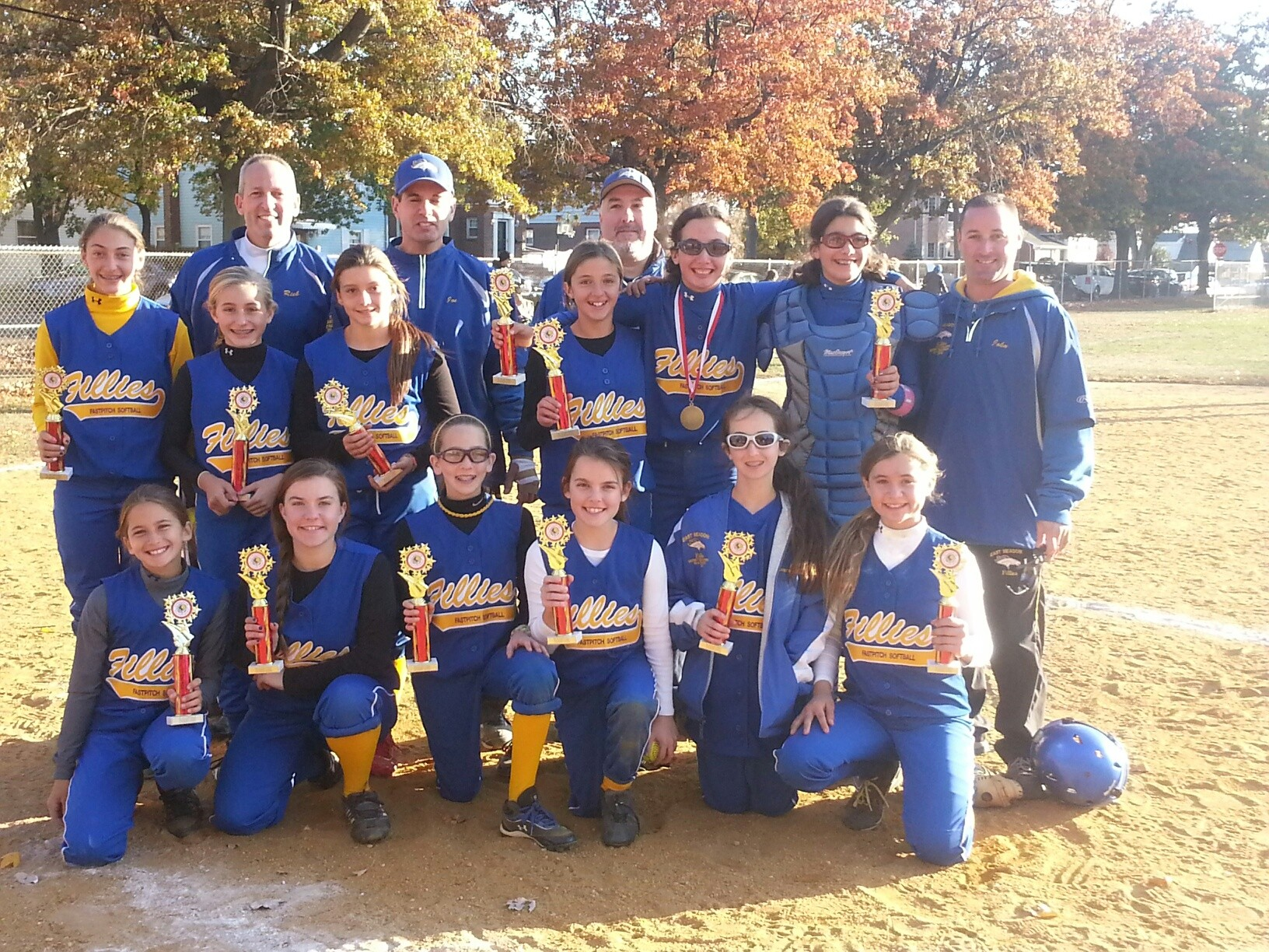 The East Meadow Fillies with their championship trophies