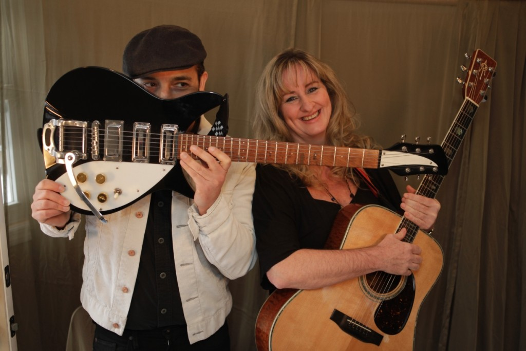 Chris James and Annie Mark open the musical festival at the Long Beach Public Library on Friday.