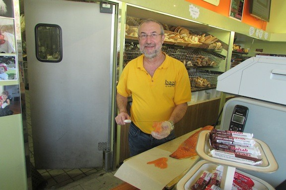 Bagel Plaza owner Sam Asatur showed his salmon-slicing skills. Bagel Plaza is celebrating its 50th anniversary this year.