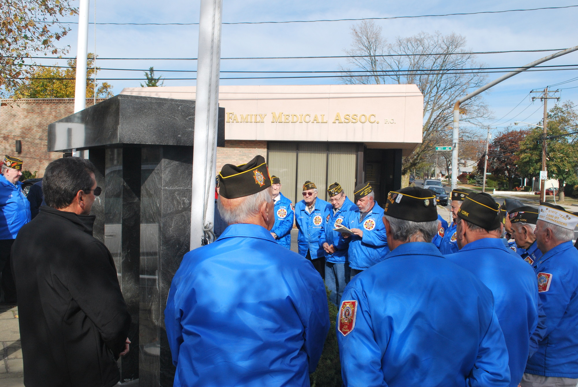 Inwood Post 1582 held its annual Veterans Day ceremony on Monday. Post Commander Joe Squitieri (with book) conducted the service.