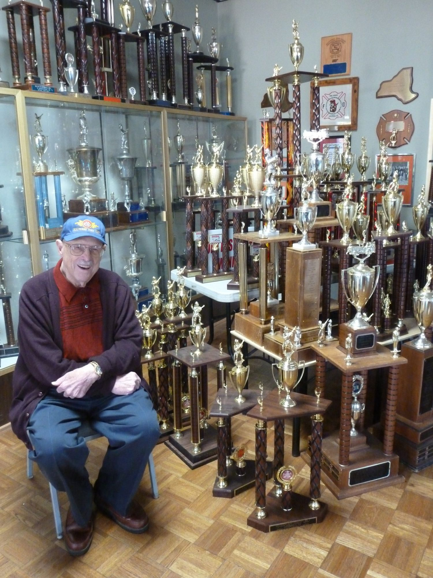 Amedeo dePoto showed off a slew of trophies that he earned with the Chipmunks drill team, which he led for 20 years.