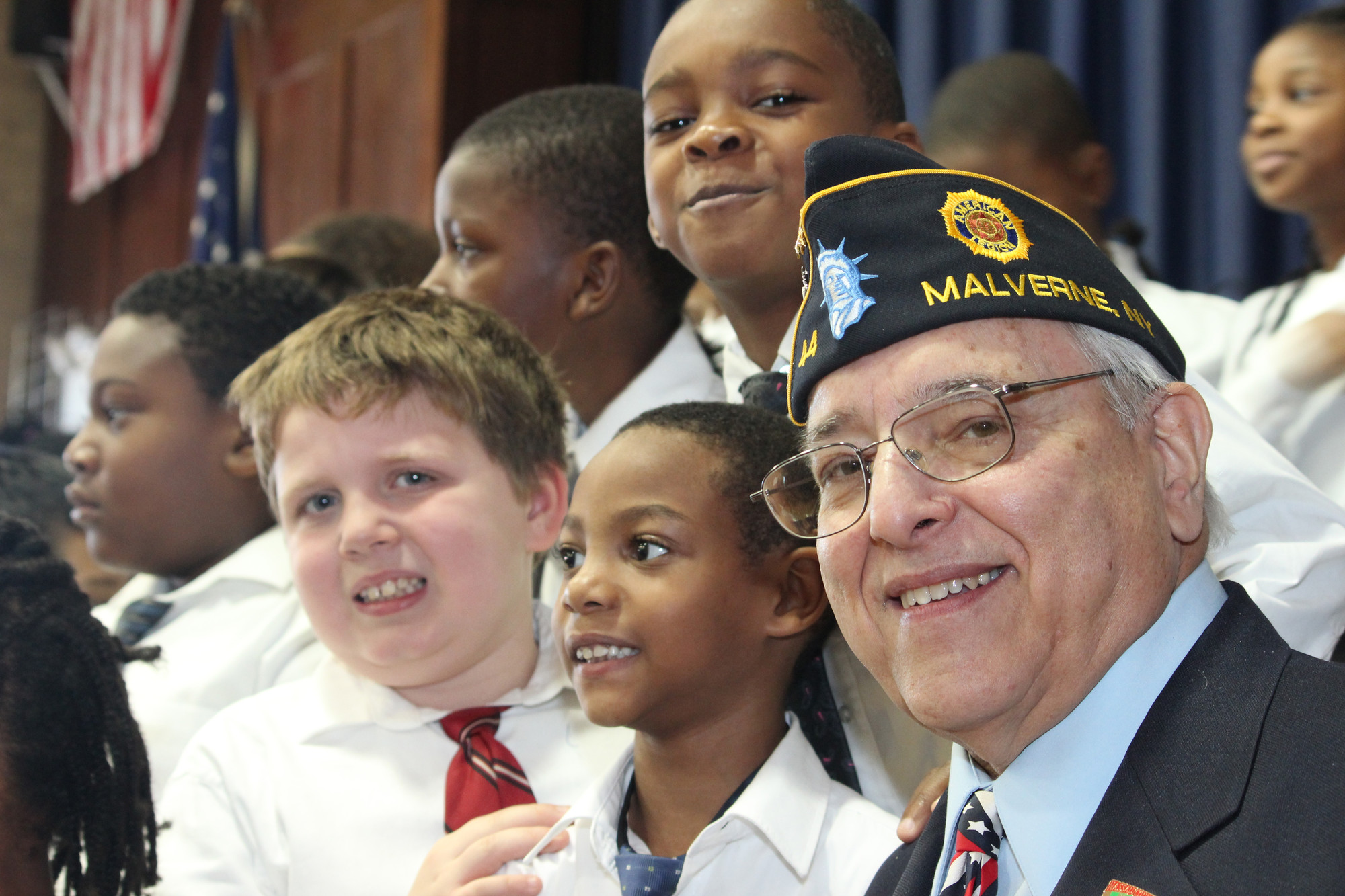 Peter Zullo, an Army veteran of the Vietnam War and Past Commander of Malverne American Legion Post 44, enjoyed listening to the songs performed by third graders Nick Canny, left, and Jordan Smith, center.