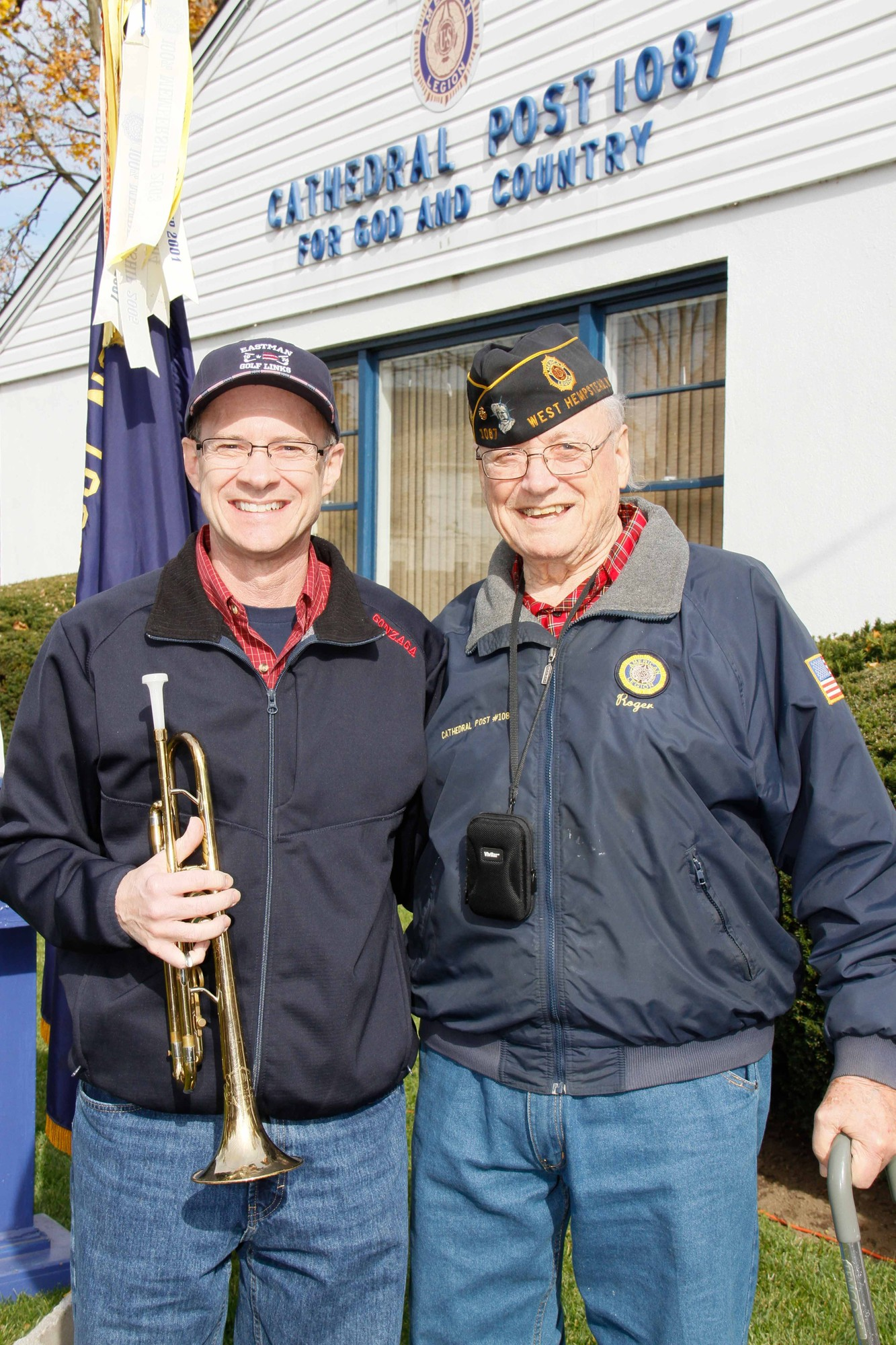 Veteran Rodger Eastman, right, stood by his son Ken, who performed