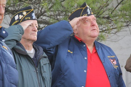 Patrick Middleton, Army, and Bob Pickering, Army 73rd Airborne, salute the flag.