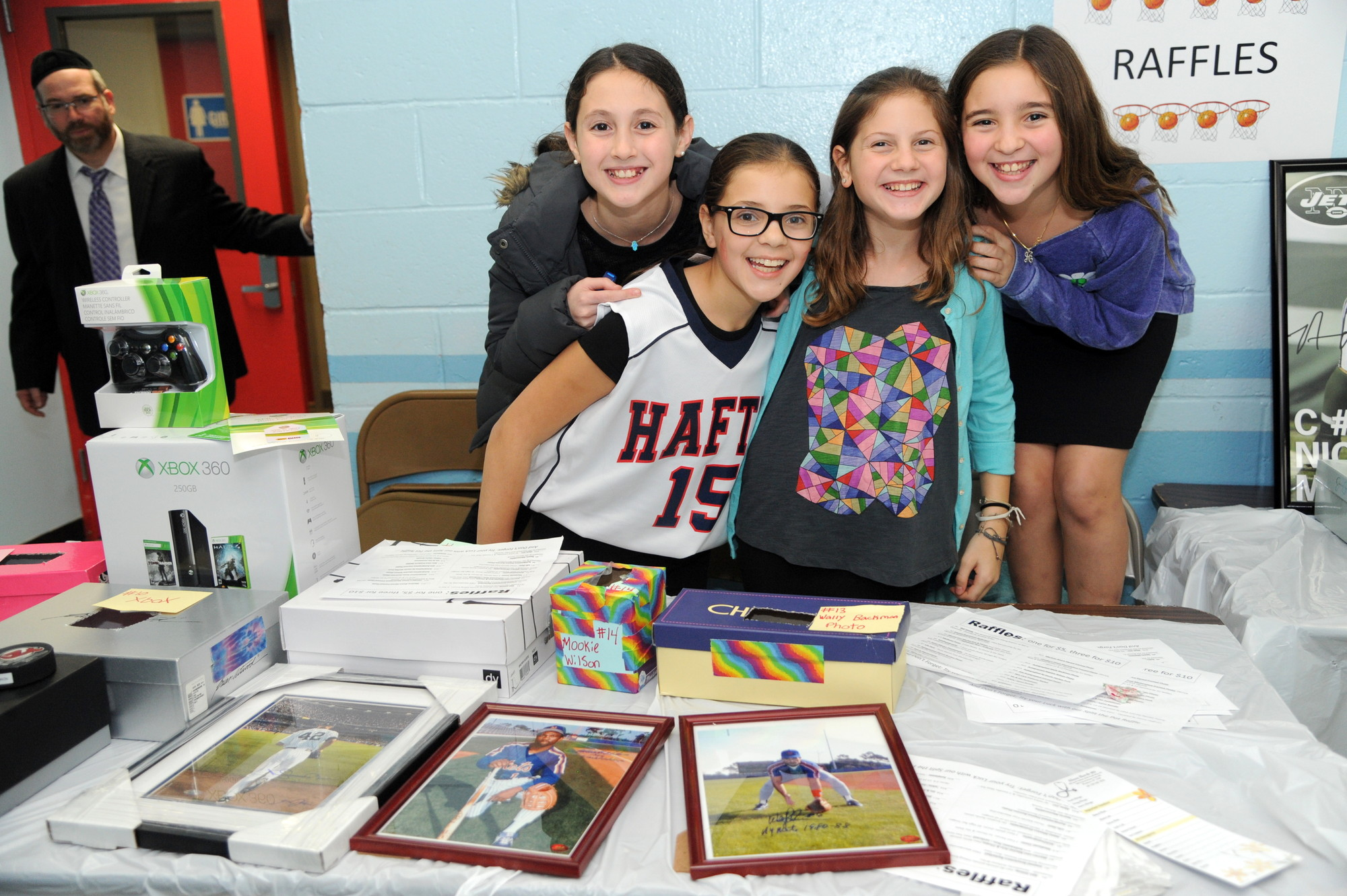 Raising over $6,000 took more than a basketball game. From left were  Kira Solomon and Jessica Kornblum, both 11, Eliana Lazar, 12, and Ashley Van, 11, helped sell raffle tickets.