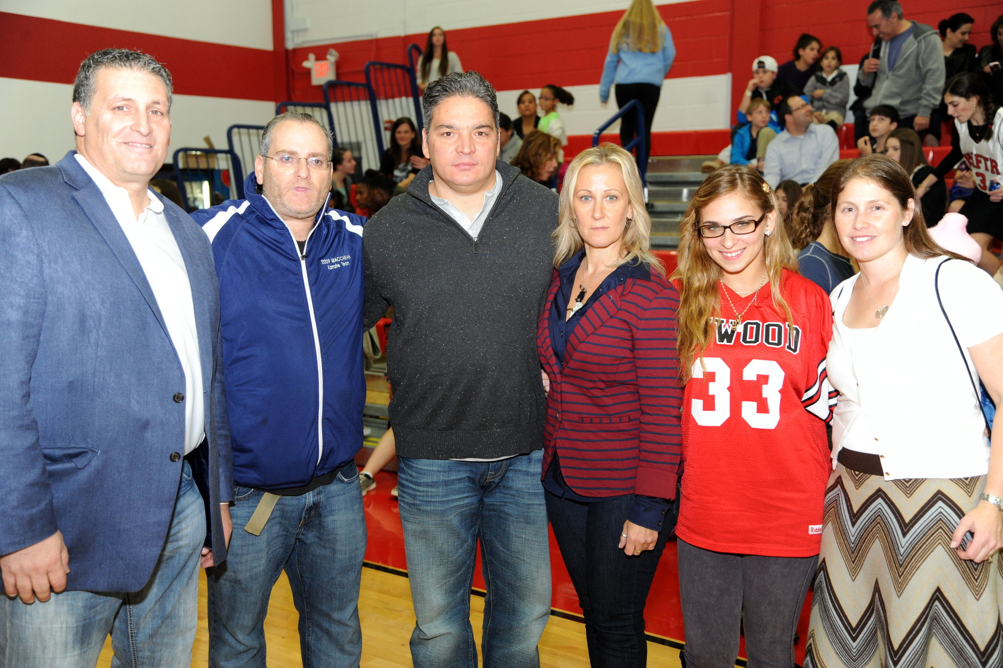 The HAFTR Hawks and Inwood Buccaneers played a basketball game in memory of Gio Cipriano. From left were organizers Frank DeCicco Jr. and David Loniado, John, Georgina and Gianna Cipriano, and Sami Loniado.