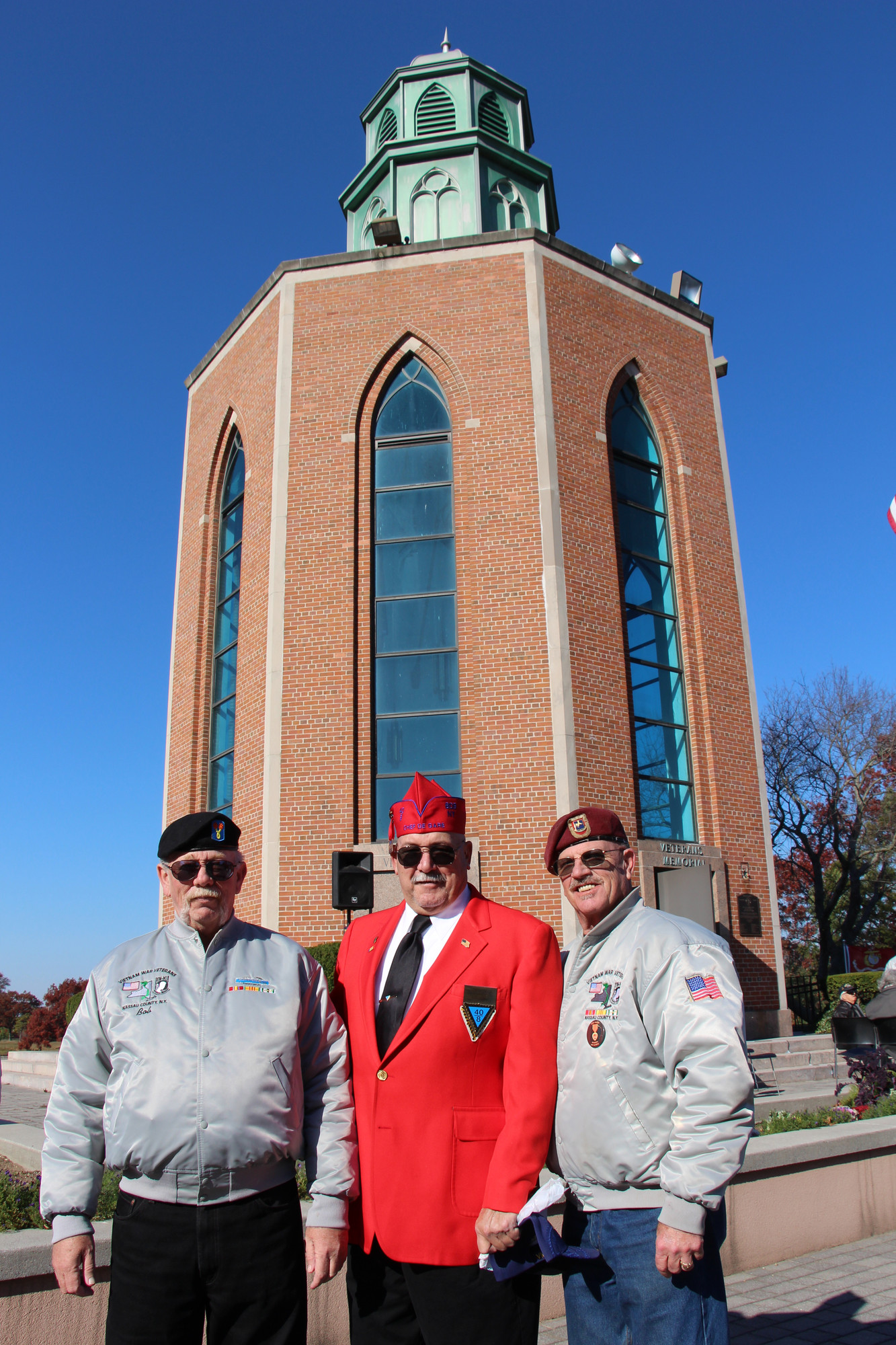 Pat Yngstrom, of Merrick, Kevin Lawlor, of East Rockaway, and Bob Reichel, also of Merrick, joined together in Veterans Memorial Plaza in Eisenhower Park on Sunday.