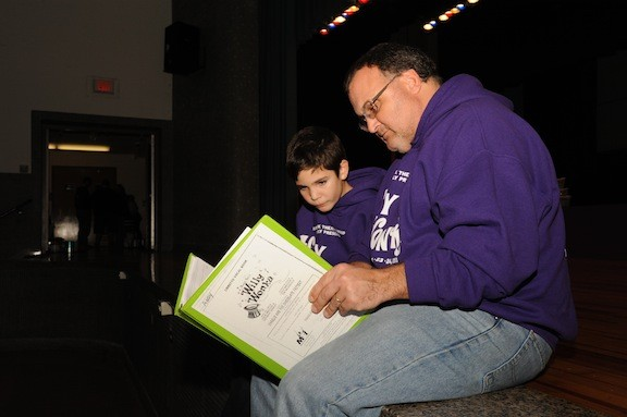 Ben Upbin and his dad, Andrew, go over their lines before a run-through.