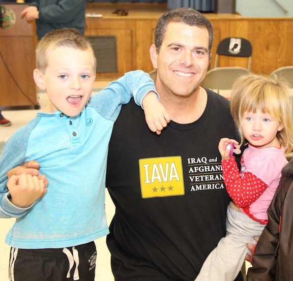 Tom Yannelli, an Iraq and Afghanistan veteran, with his kids, Dylan and Keira.