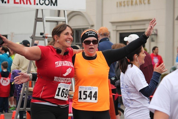 Kristina Gozaloff, left, and Alicia Delano of Selden celebrated their completion of the 10k.