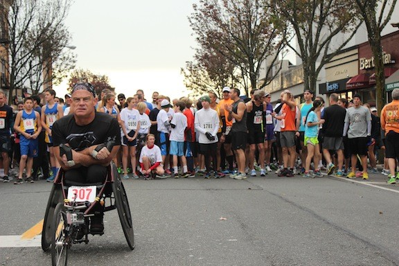 Wheelchair athlete Peter Hawkins mentally prepared himself at the starting line.