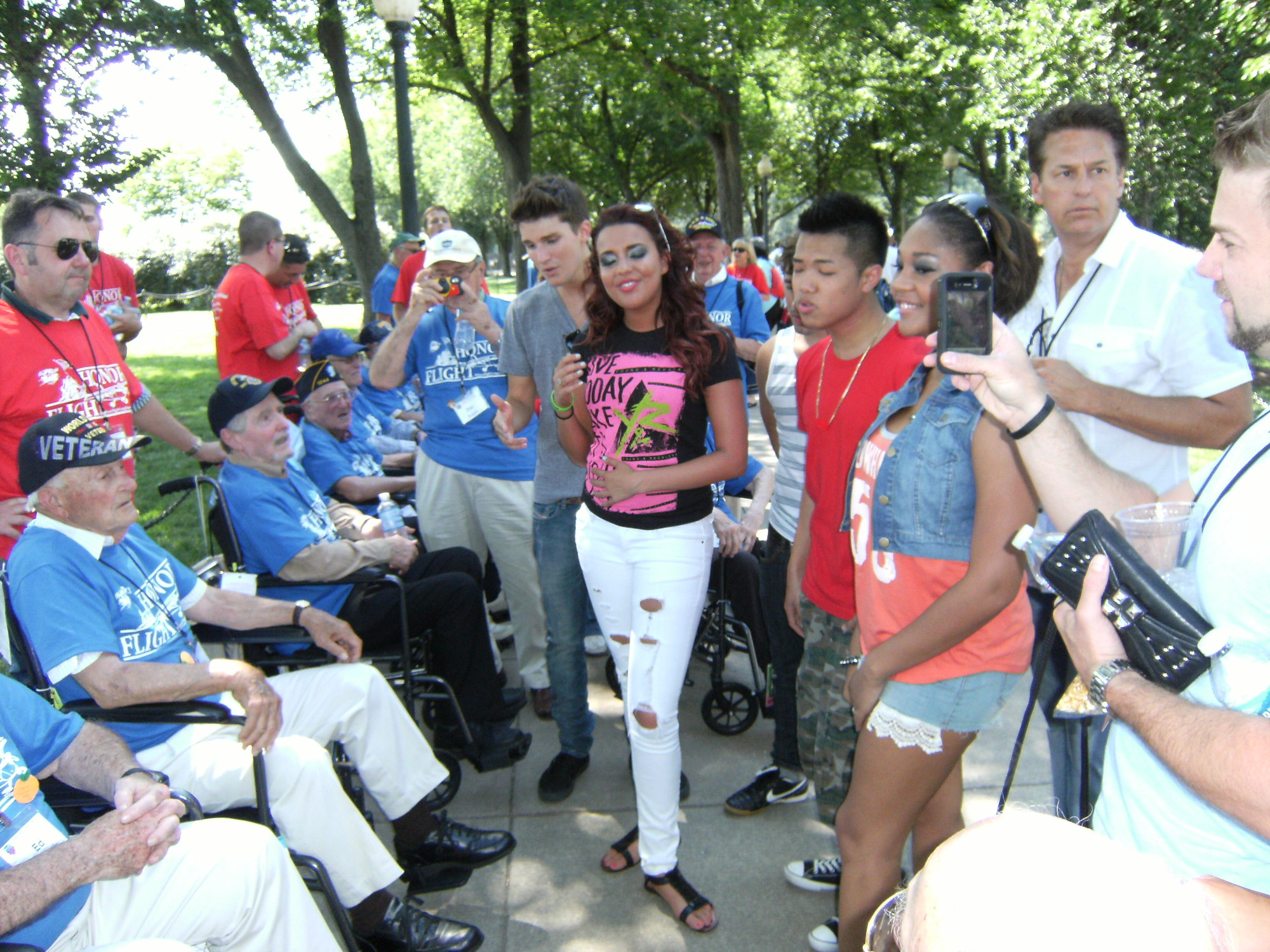 Onlookers in Washington, D.C., rushed to greet and photograph the veterans at the Washington Monument during an Honor Flight trip in June 2012.