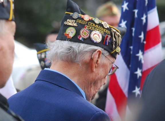 Vincent Gabriele, a past commander of Merrick American Legion Post 1282, bowed his head in silence in remembrance of America's war dead.