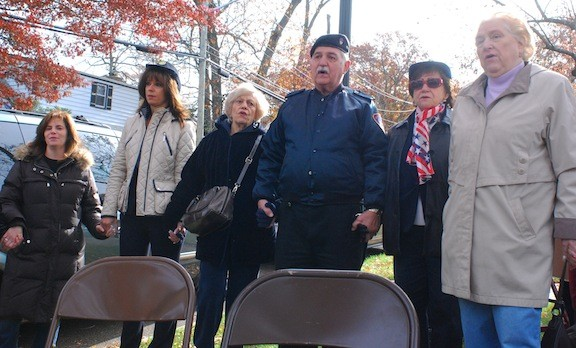 "Veterans, Ladies Auxiliary members and residents held hands and sang ""God Bless America"" at the ceremony's end."