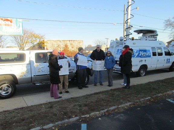 Demonstrat0rs from other school districts who had no tickets to enter the Mineola High School auditorium, picketed outside the building.