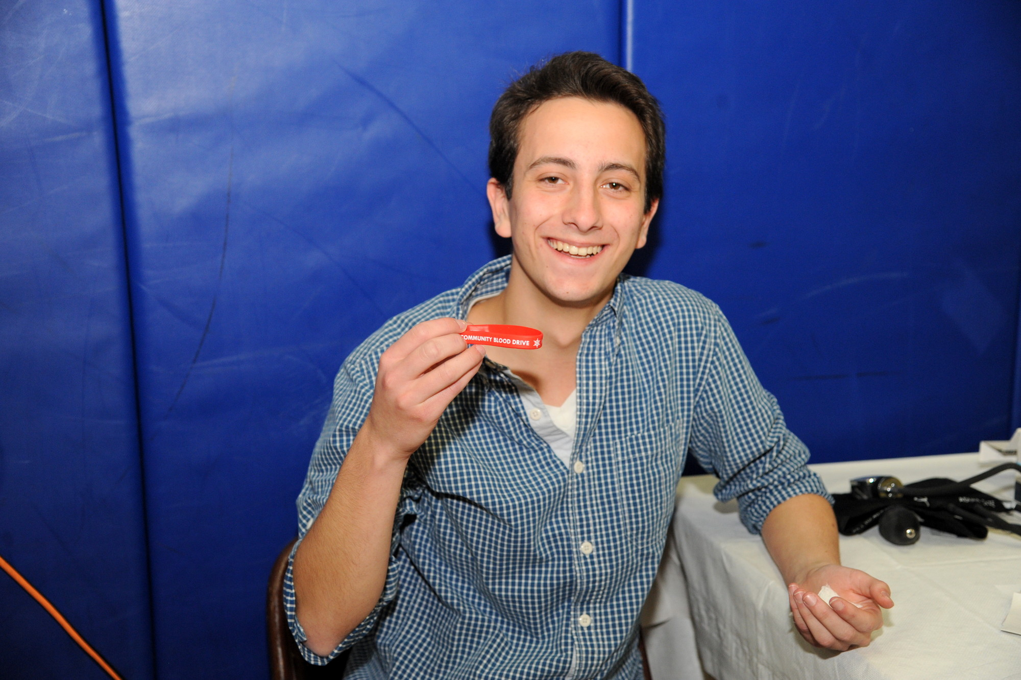 David Stein, 17, shows his bracelet for Super Bowl tickets.