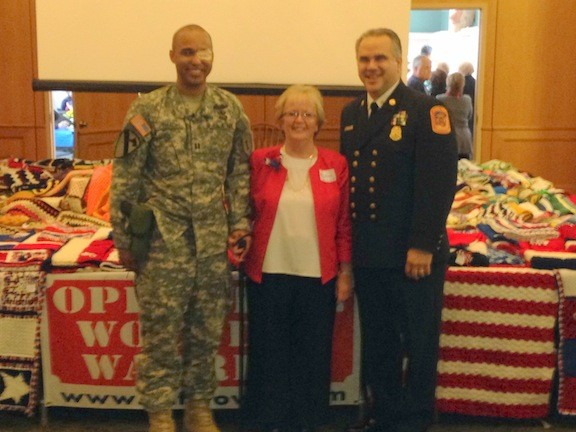 Barbara Barnhart, of Stitches from the Heart, met with Nassau County Firefighters Operation Wounded Warrior Chairman Joseph O