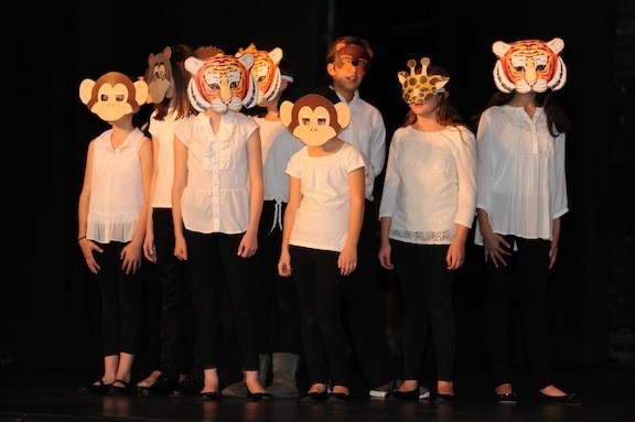 Minimalistic costumes were used to create the menagerie ensemble needed for numbers from The Lion King.