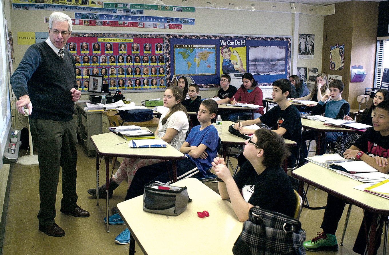 Michael Dolber, a retired Merrick Avenue Middle School social studies teacher, was 13 years old when President Kennedy was killed. He was in French class when word reached his junior high school that the president was dead. He was pictured here teaching at MAMS last February, shortly before his retirement.